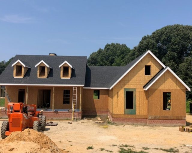 home under construction with asphalt shingles