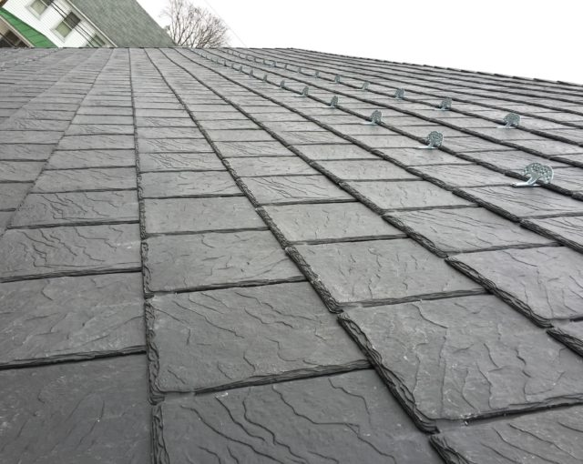 slate roofing with residential property in background