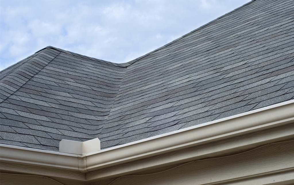 Gray asphalt shingle roofing up close