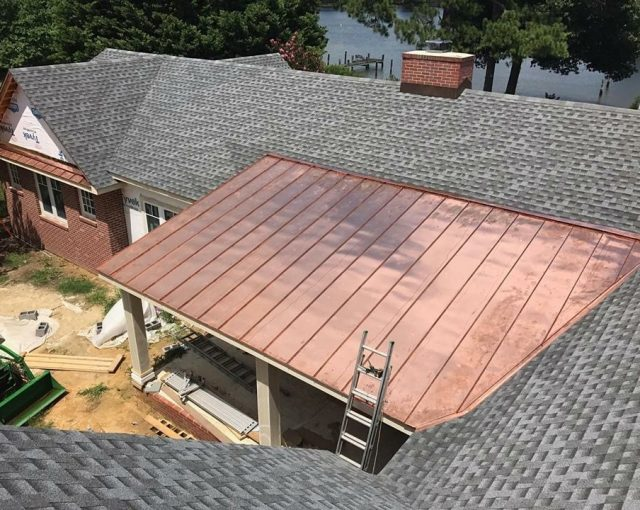 A copper metal roof installed on a residential home