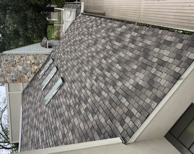 Grey shingles on a roof after a replacement