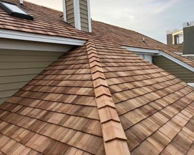 Brown cedar shake roof on a residential property