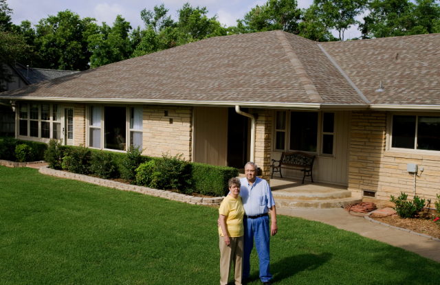 Happy homeowners enjoying their new roof financing options